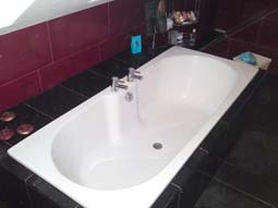 Fitted bathroom and granite floor tiles
